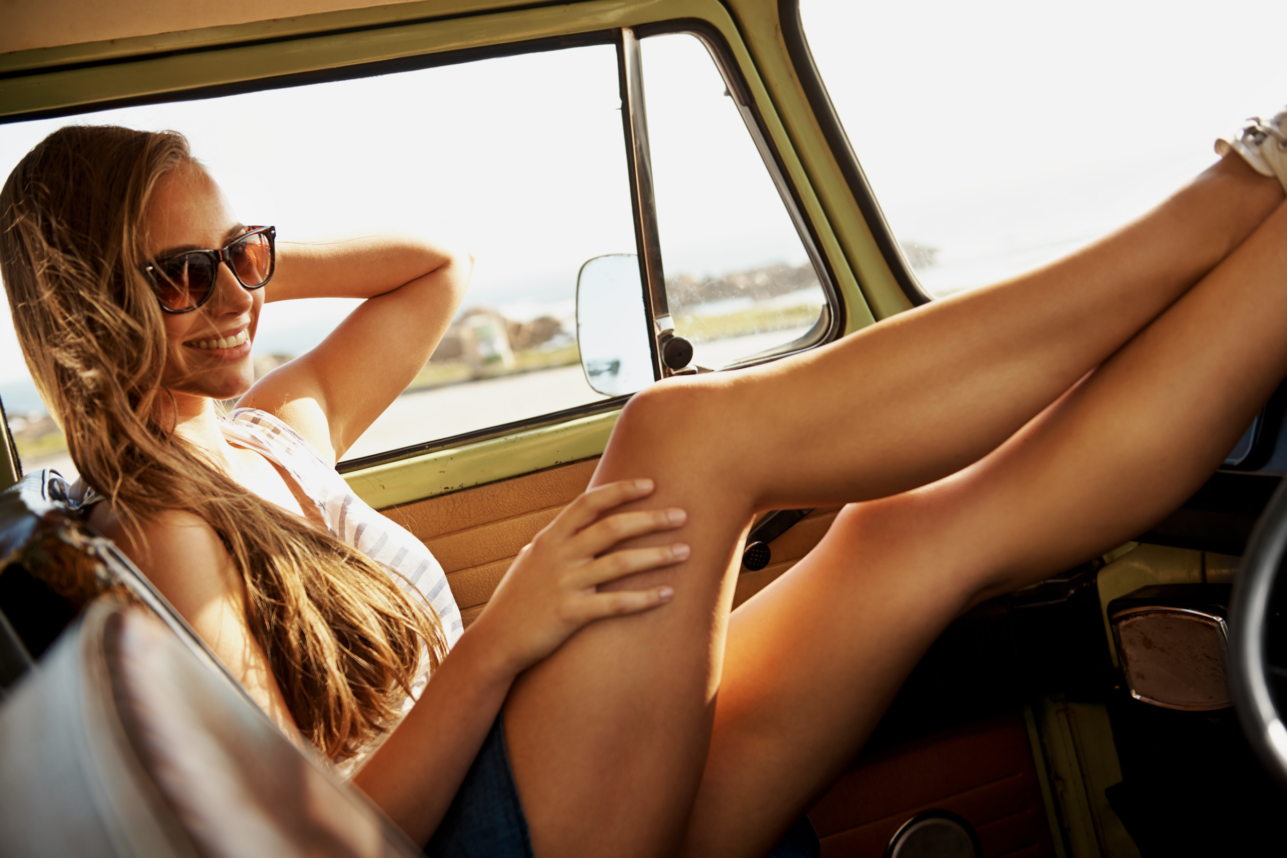 A young woman relaxing in a van during a road trip http://195.154.178.81/DATA/istock_collage/0/shoots/784360.jpg